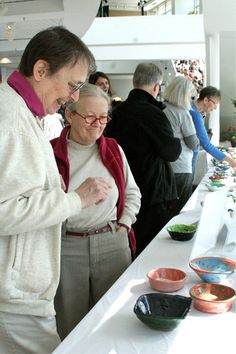 Attendees peruse some of the many bowls available at the 2012 Empty Bowls event.