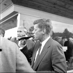 JFK enjoying a Coca-Cola while campaigning for president in October 1960.