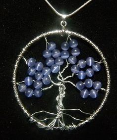 I'd love this with little amber beads - Tree of Life...would love to learn to work with wire