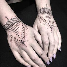Matching Mentawai inspired ornamental tattoo on both hands.