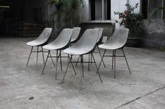 Concrete dining chairs handmade industrial design feature for the home or work place. High quality furniture