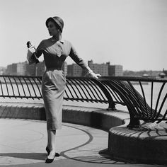 New York Fashion Design: A young woman modelling a belted dress with pencil skirt, New York City, June (Photo by Slim Aarons/Hulton Archive/Getty Images) New York Fashion, Retro Fashion, Vintage Fashion, Vintage Style, Women's Fashion, Vintage Vogue, Vintage Glamour, Classic Fashion, Vintage Girls
