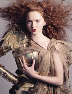 red haired woman in armor