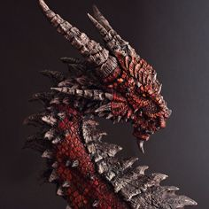 Dragon bust sculpted in super sculpey. Designed, painted and sculpted by myself.
