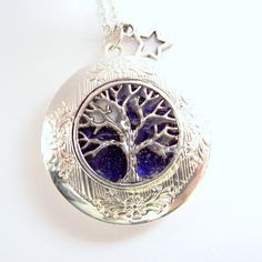 """tree necklace silver locket necklace blue moon by jinjajewellery, £15.00. Reminds me of when Seth and I were dating and I asked if he could be any other living thing what would it be and he answered """"A redwood tree""""."""