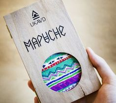 Mapuche by Alina Kazachuk, via Behance - Outer sleeve has a subtle, natural texture printed on it that makes a nice contrast with the bright patterns exposed by a cutaway window
