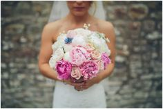 """Bridal Bouquet of hand gathered Peonies in a selection of shades including """"Pure"""" white, the shell pink """"Gardenia', deeper pink """"Sarah Bernhardt"""" and """"Dr Fleming"""" along with exquisitely """"lacey"""" and sweet scented Lily of the Valley, White Dill and pale andvibrant blue """"Love in the Mist"""", Floribunda Rose Bombastic, it's a bit of a flower bomb all round and mega multi petalled, with Sweet Avalanche and David Austin's English Garden Rose Keira for a bit more Rosey fragrance"""
