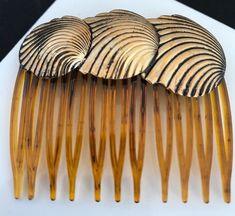 https://www.ebay.com/itm/Vintage-Hair-Comb-Antique-Gold-Tone-Shell-Design-Nautical-RARE-Never-Worn-13D/253504680878?hash=item3b060e73ae:g:ke4AAOSwzrBasDaZ