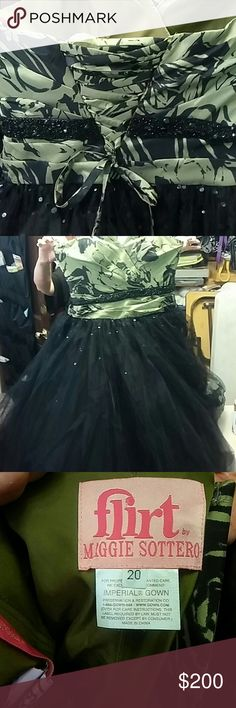 Green corseted chifon prom dress Multi layers of tulle and skirting. Very good condition. Only worn once and has been in a garment cover since. The green is a mossy color. Their are little pieces of sequins in the tulle skirt. flirt Dresses Prom