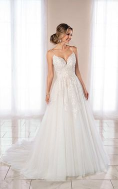 Ballgown wedding dress with lace, beaded bodice with spaghetti straps.