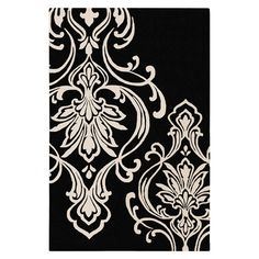 Add a pop of pattern to your living room or den with this hand-tufted wool rug, showcasing a damask motif in black and white.  Produ...