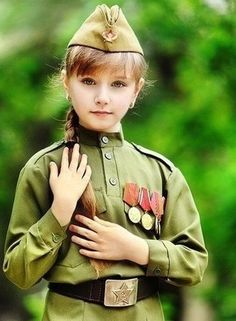 A Russian girl dressed in a World War II Red Army uniform to celebrate Victory Day in Volgograd, the wartime Stalingrad (May Russian Beauty, Russian Fashion, Russian Style, Military Women, Military Jacket, Cute Little Girls, Cute Kids, Army Uniform, Female Soldier