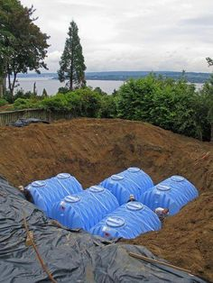 These below-grade cisterns will be capped by a lawn.
