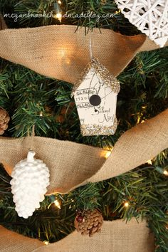Rustic Christmas Tree with burlap and whites. I think I know what to do with the 500 pine cones we have sitting at the church. . . Spray paint them white and hang them on the big blue and white tree!
