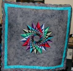 Costa Rican Cartwheel, This quilt was done with paper piecing, batik fabric, and is one of my all time favorites., The pattern for this quil...