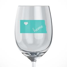 North Dakota Home Wine Glass. Our Handmade State Wine Glasses make perfect gifts for any occasion. This personalized wine glass features the state of North Dakota. Show your love for your home state. Price is for one wine glass. Decals are permanent vinyl adhesives, but can lift over time if not cared for properly. To wash, hand wash and air dry. Do not put in dishwasher as heat will make the vinyl adhesive weak and it can peel off. All of our items are made in a smoke-free home, with...