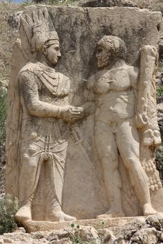 Relief at the ruins of Arsameia, the capital of the kingdom of Commagene, 1st century BC.    King Mithradates I Kallinikos of Commagene (100–70 BC) dressed as the Zoroastrian Magi (left) shakes hands with the Greek demigod Hercules.