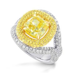 Fancy Vivid Yellow Cushion Diamond Halo Ring, (5.66Ct TW) . Amazingly intesne Yellow Diamond ring surrounded by a rich double halo of round Yellow Diamonds and round White Diamond Brilliants, this stunning piece of unique diamond jewelry is worthy of a Princess.