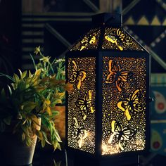 Elegantly crafted metal tealight lantern featuring a butterfly fluttering laser cut pattern. Gold Lanterns, Metal Lanterns, Lanterns Decor, Hanging Lanterns, Candle Lanterns, Paper Lanterns, Tea Light Candles, Metal Sheet Design, Goth Home Decor