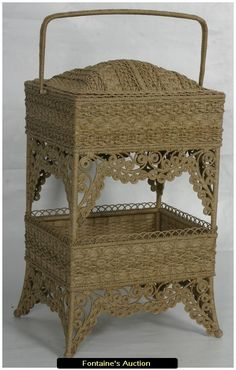 """Fancy Victorian Natural Wicker Sewing Basket. A two tier dome top basket and a swivel handle; below is a second open tier. Stands on long legs running top to bottom and has fancy scrolling aprons. Excellent condition. 22""""W x 34.5""""H x 18""""D. Estimated Value$1,500 - 2,000."""