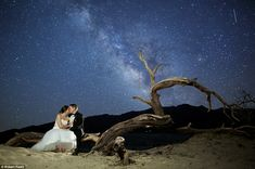 Everybody's starry-eyed: No engagement ring could steal the limelight from the galaxy of twinkling stars in the skies above this couple