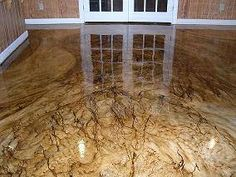 Stained concrete flooring I would love to pull up my carpet & do this to the floors.