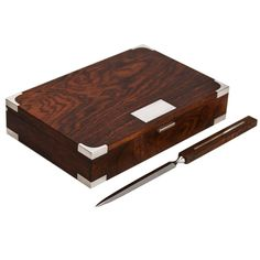 Hans Hansen, Sterling and Brazilian Rosewood Box and Letter Knife Set | From a unique collection of antique and modern desk accessories at https://www.1stdibs.com/furniture/decorative-objects/desk-accessories/