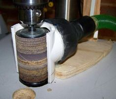 drill press spindle sander with vacuum attachment.