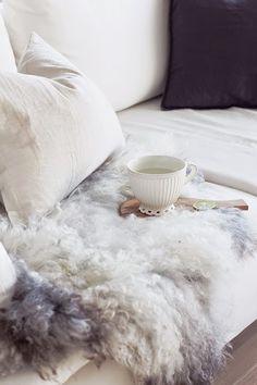 www.thewhitebox.no  Scandinavian interior design. Söderhamn sofa from IKEA, Norwegian sheepskin. Olive tree cutting board.