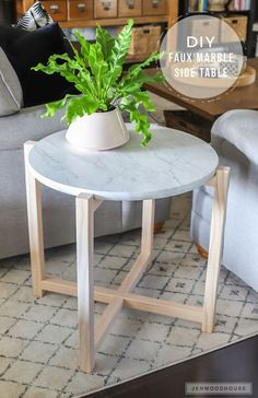 Add a sleek modern touch to your living space with this round faux marble side table. You just need 2 boards and a store-bought round tabletop to make it!