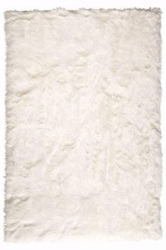 Freshen up your bathroom, or foyer this Spring..affordable 3 X 5 Faux Sheep Skin Area Rug