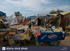 http://www.alamy.com/stock-photo-food-stalls-amid-tents-made-of-sheets-at-a-temporary-makeshift-dwelling-28982713.html