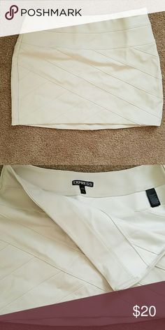 Leather skirt White leather mini skirt, with bandage pattern. Worn once, perfect condition! Express Skirts Mini