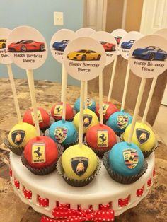 Sports car themed cake pops. Lamborghini, Ferrari, Porsche cake pops for car enthusiasts.
