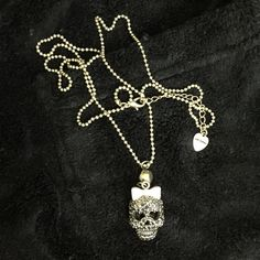Betsey Johnson Black Rhinestone Skull Necklace Here's a girly skull necklace by Betsey Johnson. The brass, ball chain is 30 inches long and it has an extender. The sparkly skull is covered in pave' set black rhinestones, she's wearing a pink bow, and is suspended from a large rhinestone. The rhinestone and skull hang 2.5 inches long. And .75 inches wide. Sparkly, girly, cool! Betsey Johnson Jewelry Necklaces