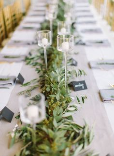Garland Greenery + Tall Candles the length of the tables. Photographie LLC - www.loftphotographie.com | Floral and Greenery Garland Wedding Decoration | fabmood.com #garland #weddingreception #tablerunner