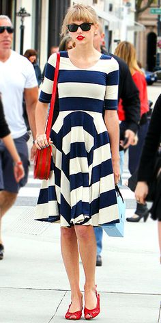 TAYLOR SWIFT  The crooner knows how to pack a retro punch into an understated outfit. By accenting her striped navy-and-white dress with red accessories, like a Lauren Merkin bag (and a matching pout, natch!), Taylor makes a major impact without looking like she's trying too hard.