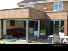 Corner bi-folding doors fully extended back House Plans, L Shaped Kitchen Extension, Open Plan Kitchen Dining, Bifold Doors, New Homes, House Extension Design, House, Garden Room Extensions, Folding Doors
