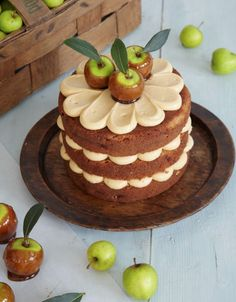 This Toffee Apple Cake: This might just steal the show this Thanksgiving! It is a deliciously moist apple cake, packed with nuts and spices and decorated it with tiny apples dipped in golden caramel. #COTD