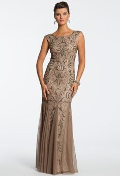 This long gown is full of coveted details that any woman would want for their dream formal dress! As a more sophisticated homecoming dress, guest of wedding dress, or holiday dress this vintage inspired floor-length gown is a winner for any chic party setting. Gorgeous cap sleeves and scoop neckline bring attention up towards your face while an ornate beaded design fills the entire length of the dress. Sheer godets complete the long skirt with some drama making for one completely stunning…