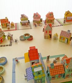 This adorable little village of paper-and-washi-tape houses is made from a book called Mon Village by Delphine Doreau. The beauty of the project is that kids can keep adding to the town as they acquire new tape.  Source: Tambouille