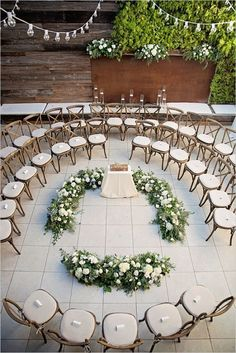 Incredible Wedding Decor Ideas for Your Ceremony Altar | Place your chairs to circle around you and your honey for the nuptials so everyone has a great seat with a different view. This bride chose to have floral arrangements all around them for the ceremony.