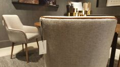 Chairs by Anatomy Design, upholstered in Melange Slub colour Taupe