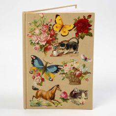 13213 Een notitieboek met een collage van vintage Die-Cuts