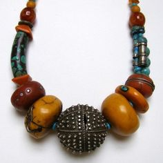 Tory Hughes: AmberTurquoise Berber Bead Necklace: Amber, copal, coral and larger turquoise beads are made out of polymer clay