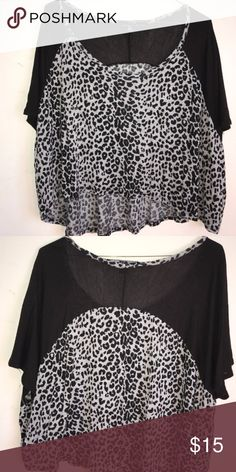 forever 21 top Cute cheetah/black top. Worn a few times, in new condition. Accepts offers. Offers/purchases only made through here. No trades. Thank you :) Forever 21 Tops Crop Tops