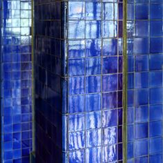 Blue tiles reflections columns details at Scotland Street School, built by Charles Rennie Mackintosh, is a museum of school education in Glasgow, Scotland.
