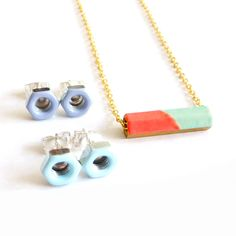 Bolts dipped in color made into earrings. Lovely idea.