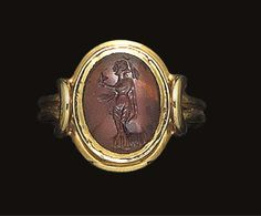 A SASSANIAN GARNET INTAGLIO OF A FEMALE OFFRANT -  3RD-4TH CENTURY A.D.