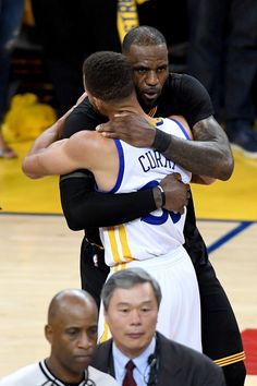 LeBron James Photos Photos - Stephen Curry #30 of the Golden State Warriors hugs LeBron James #23 of the Cleveland Cavaliers after defeating the Cleveland Cavaliers 129-120 in Game 5 to win the 2017 NBA Finals at ORACLE Arena on June 12, 2017 in Oakland, California. NOTE TO USER: User expressly acknowledges and agrees that, by downloading and or using this photograph, User is consenting to the terms and conditions of the Getty Images License Agreement. - 2017 NBA Finals - Game Five